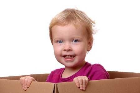 Portrait of a happy young toddler sitting in a box Stock Photo - 17342158