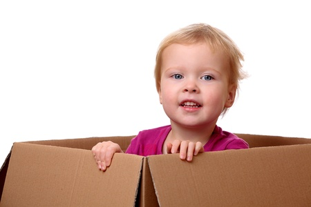 Portrait of a happy young toddler sitting in a box Stock Photo - 17330102