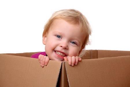 Portrait of a happy young toddler sitting in a box Stock Photo - 17329318