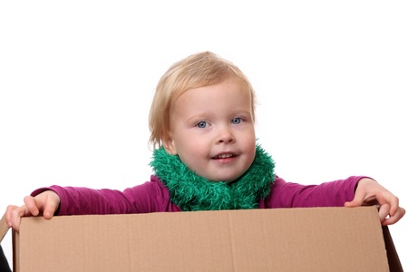 Portrait of a happy young toddler sitting in a box Stock Photo - 17330031