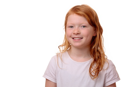 Portrait of a young red haired girl on white background Stock Photo - 17330041