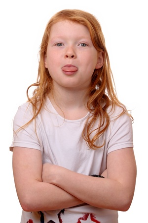 Portrait of a naughty young girl on white background photo