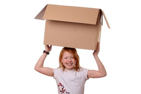 Portrait of a happy young girl carrying a large box Stock Photo - 17342159