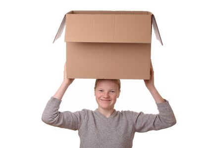 Portrait of a happy young girl carrying a large box Stock Photo - 17330028