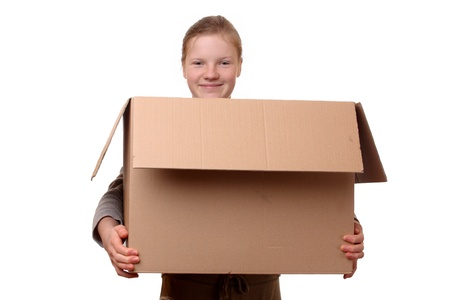 Portrait of a happy young girl carrying a large box Stock Photo - 17342160