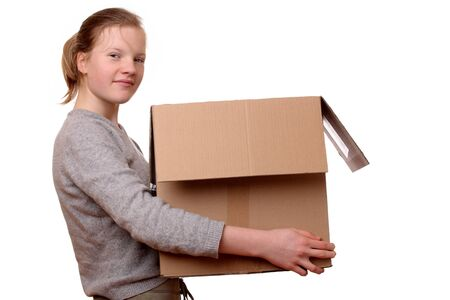 Portrait of a happy young girl carrying a large box Stock Photo - 17330038