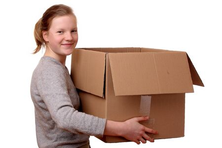 Portrait of a happy young girl carrying a large box Stock Photo - 17330042