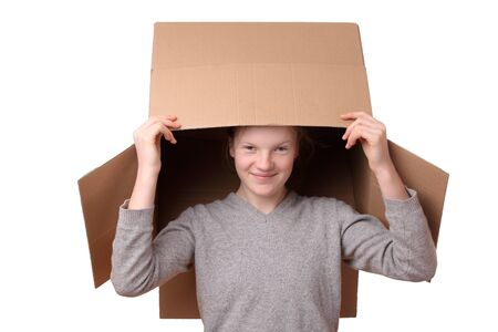 Portrait of a happy young girl carrying a large box Stock Photo - 17342155