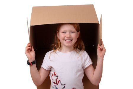 Portrait of a happy young girl carrying a large box Stock Photo - 17330114