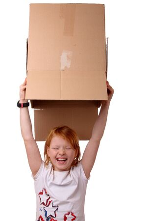 Portrait of a happy young girl carrying a large box Stock Photo - 17330039