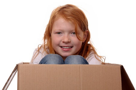 Portrait of a young girl sitting in a box Stock Photo - 17330051