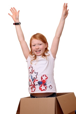 Happy young girl jumps out of a box Stock Photo - 17330029