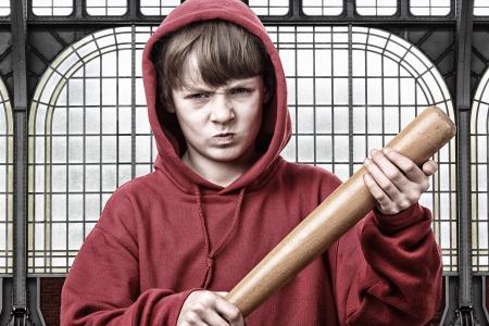 aggresive: Young aggresive teenage boy with a baseball bat