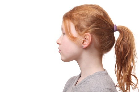 red head girl: Portrait of a young red haired girl with ponytail on white background
