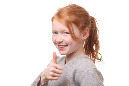Portrait of a successful girl with thumbs up on white background photo
