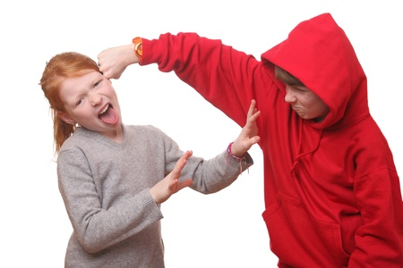 Two angry children on white background photo