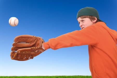 Young boy tries to catch a baseball Stock Photo