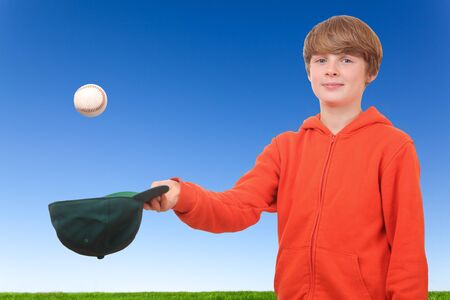 tries: Young boy tries to catch a baseball Stock Photo