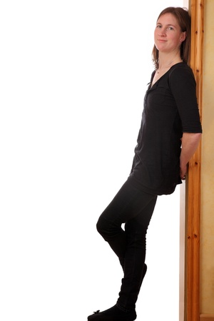 Portrait of a young woman leaning against a door case photo