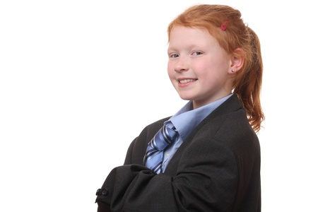 Young girl in an oversized business suit on white background photo