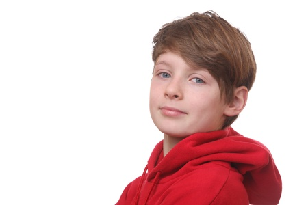 Portrait of a happy young boy on white background photo