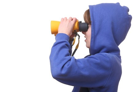 Portrait of a young boy with binoculars on white background