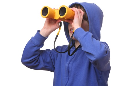 Portrait of a young boy with binoculars on white background photo
