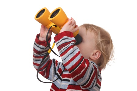Portrait of a toddler with binoculars on white background photo