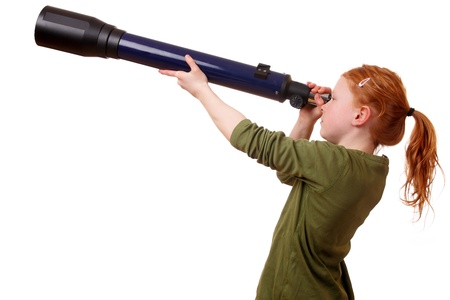 Young girl looks through a telescope on white background photo