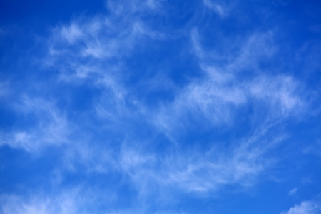 Blue sky with some white cirrus clouds