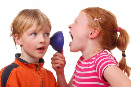 Kids shouting through a cone on white background photo