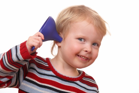 Young kid with an ear-funnel on white background photo
