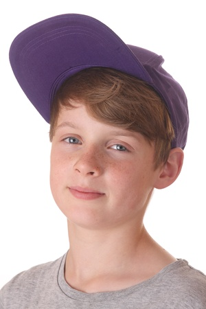 Portrait of a happy teenage boy with cap on white background