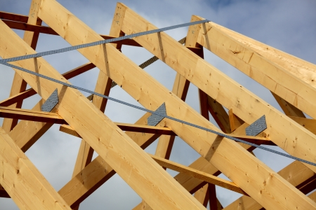 A new build roof with a wooden truss framework photo