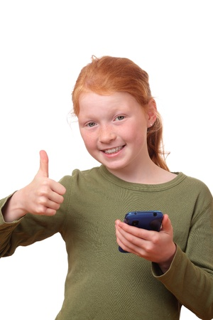 Red haired girl with smartphone shows thumbs up photo