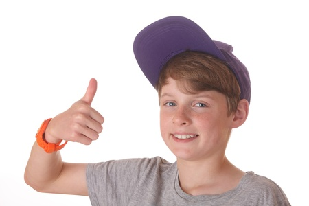 Portrait of a teenage boy with cap and thumbs up Stock Photo