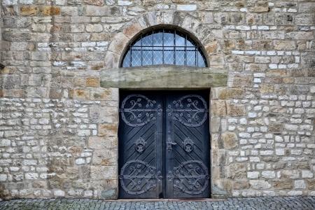 Ancient wooden door in an old castle photo
