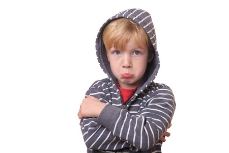 offended: Portrait of a young offended boy on white Background