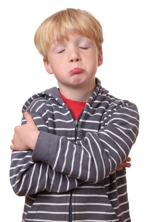 Portrait of a young offended boy on white Background photo