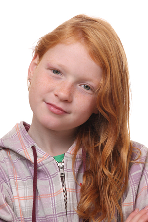Portrait of a red haired girl on white background photo