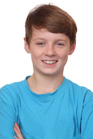 Portrait of a smiling young boy on white background photo