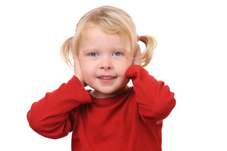 Portrait of a little girl covering her ears on white background Stock Photo