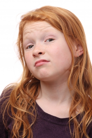 skeptic: Portrait of a skeptical young girl on white background