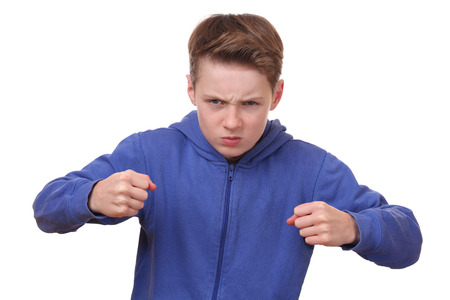 Angry young boy is ready to fight photo