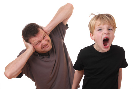 Screaming young boy and man covering his ears Stock Photo