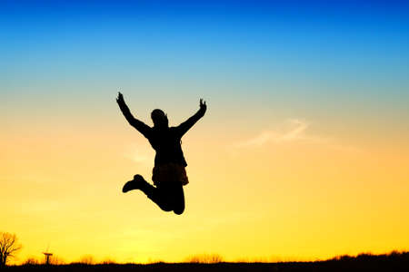 Active girl jump in meadow at sunset photo