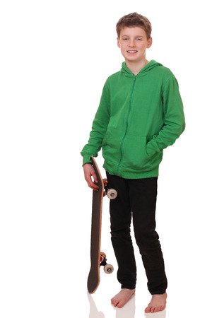 Portrait of a teenage boy with skateboard on white background Stock Photo