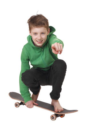 Portrait of a teenage boy with skateboard on white background photo