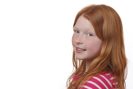 Young red-haired girl with freckles on white background Imagens