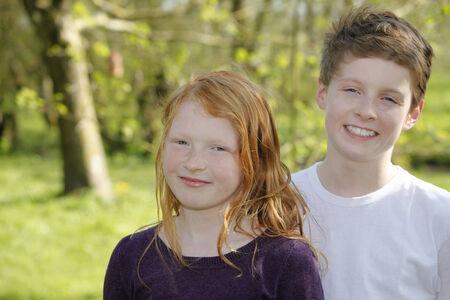 Two happy kids outdoor in the garden photo
